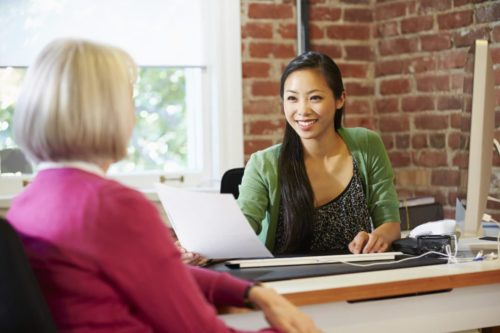 Businesswoman Interviewing Female Job Applicant In Office